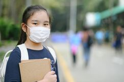 Back to school. asian child girl wearing face mask with backpack  going to school .Covid-19 coronavirus pandemic.New normal