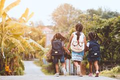 Asian pupil kids with backpack going to school. Back to school. Asian pupil kids with backpack going to school together in vintage color tone royalty free stock photography