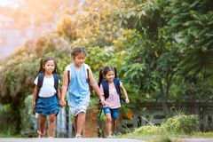 Asian pupil kids with backpack going to school Royalty Free Stock Photos