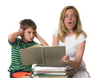 Back to school-back to reality. Angry mother trying to teach her son while he is confronting Stock Photography