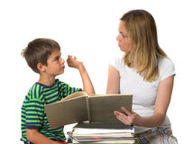 Back to school-back to reality. Angry mother trying to teach her son while he is confronting Royalty Free Stock Photo