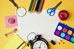 Back to school background with blank white paper and school supplies. View from above Stock Photo