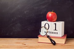 Back to school background with book, apple and calendar Royalty Free Stock Photography