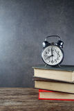 Back to school background with books and alarm clock Stock Images