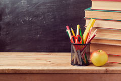 Back to school background with books, pencils and apple Royalty Free Stock Photography