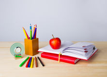 Back to school background with books, pencils and apple over wooden table stock image