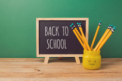 Back to school background with chalkboard and  pencils in emoji jar Stock Photography