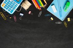 Back to School background concept. School supplies on a chalkboard background. Education background concept with copyspace. View. From above. Flat lay royalty free stock photo