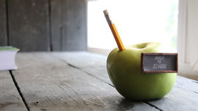 Back to school background - inscription and pencil and apple on the table stock video