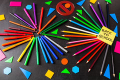 Back to school background with a lot of colorful felt-tip pens and colorful pencils in circles and title `Back to school` Royalty Free Stock Photo
