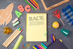 Back to school background with notebook and school supplies.View from above. Royalty Free Stock Photography