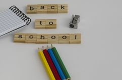 Back to school background with pens, notepad, pencil sharpener a stock image