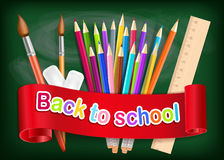 Back to school background. Rainbow pencils, brush and eraser on Stock Photos