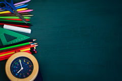 Back to School Background with School Supplies and Alarm Clock Stock Photos