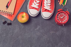Back to school background with school supplies over blackboard. Top view. Royalty Free Stock Photo