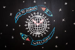 Back to school background with spaceships with flags with titles ` Back to school` and `welcome` are flying around Earth royalty free illustration