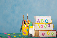 Back to school background. Back to school stationery is on the table.Blue sky coloured background Royalty Free Stock Photo