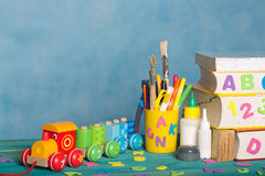 Back to school background. Back to school stationery is on the table.Blue sky coloured background Stock Photos