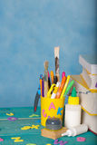 Back to school background. Back to school stationery is on the table.Blue sky coloured background Royalty Free Stock Images
