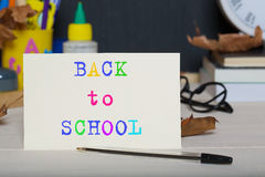 Back to school background. Back to school stationery is on the table. Chalkboard background.Back to school Royalty Free Stock Photos