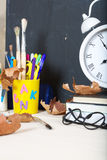 Back to school background. Back to school stationery is on the table. Chalkboard background Stock Image