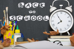 Back to school background. Back to school stationery is on the table. Chalkboard background Royalty Free Stock Photos