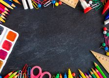 Back to school Background. School supplies on black chalk board stock photos