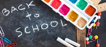 Back to school Background. School supplies on black chalk board. Flat lay. Top view royalty free stock images