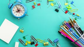 Back to school background with School supplies on green paper background ready for your design and copy space for your text stock image