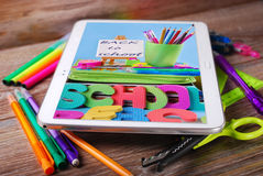 Back to school background with tablet pc displaying photo of too Royalty Free Stock Images