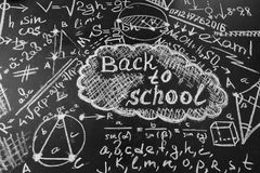 Back to school background with title Back to school and formulas written by  chalk on the chalkboard Stock Photo