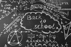 Back to school background with title Back to school and formulas written by white chalk on the chalkboard Royalty Free Stock Photos