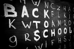Back to school background with title `Back to school` among other letters of English alphabet Stock Images