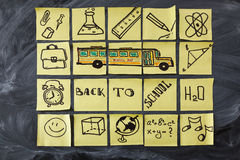Back to school background with title Back to school, school bus and school attributes written on the pieces of paper royalty free stock photography
