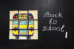 Back to school background with title `Back to school` and `school bus`  written on the yellow pieces of paper. On the  chalkboard with title `Back to school` Royalty Free Stock Images
