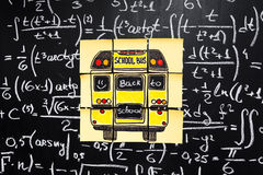 Back to school background with title `Back to school` and `school bus` written on the yellow pieces of paper. Back to school background with title `Back to Royalty Free Stock Photos