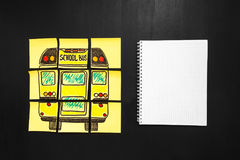 Back to school background with title `Back to school` and `school bus` written on the yellow pieces of paper and notebook. For your text are on the chalkboard Stock Images