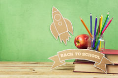 Back To School Background With Books, Pencils And Cardboard Rocket Stock Photos