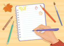 Back to school. Background with a writing or drawing hand Royalty Free Stock Photography