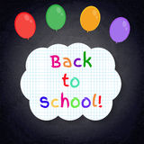 Back to school banner on lined notebook paper on chalkboard Royalty Free Stock Photos