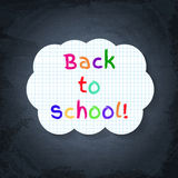 Back to school banner on lined notebook paper on chalkboard Royalty Free Stock Photography