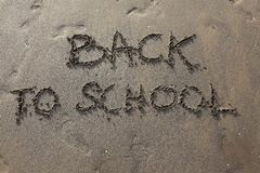 Back to School on the beach. Big written on the beach Back to School Stock Image
