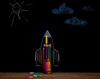 Back to school black background the missile made with pencils, drawing  crayons books Royalty Free Stock Images