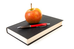 Back to school: black book with apple and pencil Royalty Free Stock Photos