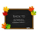 Back to School on black chalkboard with maple leaves Royalty Free Stock Photography