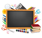 Back to school. Black desk with school supplies. Royalty Free Stock Photography
