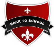 BACK TO SCHOOL on black ribbon above red shield. Illustration Royalty Free Stock Photo