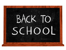 Back to school on blackboard. Back to school 3d isolated blackboard with chalk text Stock Photography