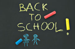 Back to school blackboard. Blackboard with the notice BACK To SCHOOL and chalks Royalty Free Stock Images