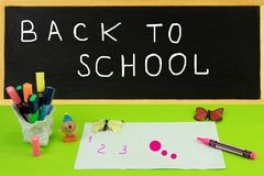 Back to school blackboard with school accessories and a paper sh stock photos